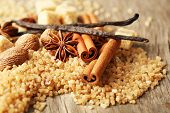 Christmas spices and baking ingredients on wooden background