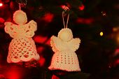picture of christmas angel  - Knitted Christmas angels on Christmas lights background - JPG
