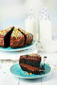 Chocolate cake with milk on table close-up