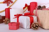 Christmas decoration of present boxes on mantelpiece on white wall background