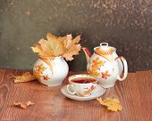 Still-life with tea, honey and autumn leaves