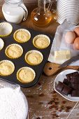 The Process Of Cooking Muffins With Raisins Vertical Top View
