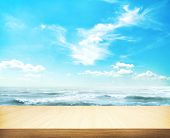 blue sky and sea with wooden table