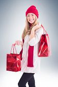 Pretty blonde holding shopping bags on vignette background