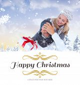 happy winter couple with gift against border