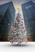 Composite image of christmas tree with falling snow