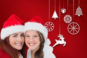 Mother and daughter against red snowflake background