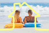 Cute couple in swimsuit sunbathing together against house outline