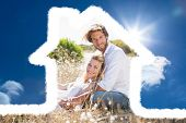 Attractive couple relaxing in the countryside against bright blue sky with clouds