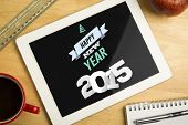 Happy new year against overhead of digital tablet