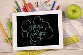 happy new year against students desk with tablet pc