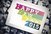 Colourful happy new year against tablet pc