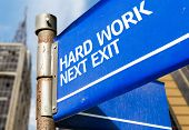 Hard Work Next Exit blue road sign
