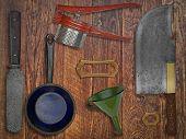 Vintage Kitchen Utensils Over Wooden Wall
