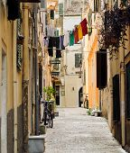 stock photo of no clothes  - Clothes on a rope in a narrow street - JPG