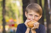 boy eating a hamburger