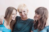 Portrait Of Three Happy Caucasian Females Wearing Dental Bracket System. Indoors Shot