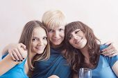 Portrait Of Three Young Caucasian Ladies Wearing Dental Bracket System. Indoors Shot