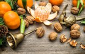 image of walnut-tree  - Mandarin oranges walnuts and christmas tree branches on wooden background - JPG