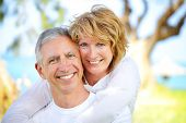 stock photo of old couple  - Mature couple smiling and embracing - JPG