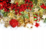 Christmas Decoration With Red Baubles, Golden Ornaments And Lights
