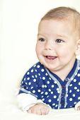 Natural Portrait Of Positive Caucasian Newborn Girl
