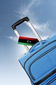 Destination Libya. Blue Suitcase With Flag.