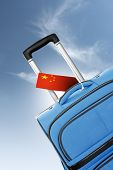 Destination China. Blue Suitcase With Flag.