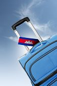 Destination Cambodia. Blue Suitcase With Flag.
