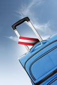 Destination Austria. Blue Suitcase With Flag.