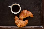 smile coffee with croissant at board
