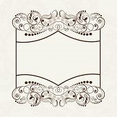 Beautiful floral design decorated blank frame on grey background.