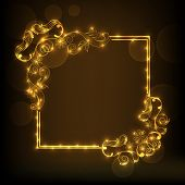 Shiny frame decorated by beautiful golden floral pattern on brown background.