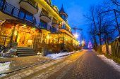 ZAKOPANE, POLAND - DECEMBER 6, 2014: Traditional restaurant at the Krupowki street in Zakopane. Krupowki street is the main shopping area and pedestrian promenade in the center of Zakopane, Poland.