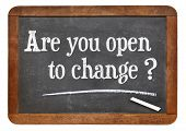 are you open to change question - white chalk text on a vintage slate blackboard