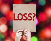 Loss? card with colorful background with defocused lights