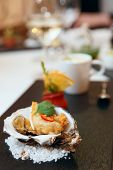 foto of oyster shell  - Tempura fried oyster in shell on restaurant table - JPG