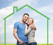 love, home, people and family concept - smiling couple hugging over green house and blue sky with grass background