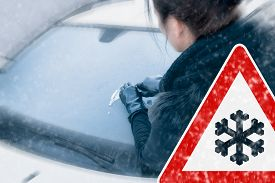 stock photo of scrape  - Winter Driving - Woman scraping ice from a windshield. ** Note: Shallow depth of field - JPG
