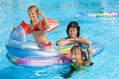 picture of swimming pool family  - Family with children in swimming pool - JPG