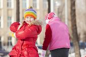 foto of snowball-fight  - Children in winter park having fun and playing snowballs - JPG