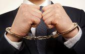 foto of handcuffed  - Arrested business man handcuffed hands - JPG