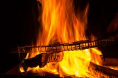 picture of brazier  - empty grill rack on fire burning in brazier - JPG