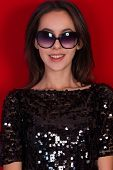 image of little black dress  - Beautiful brunette girl in a black dress and glasses - JPG