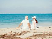image of couple sitting beach  - Couple sitting on the beach - JPG