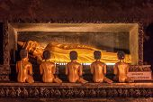 foto of cave  - Golden statue of Buddha of Nirvana in buddhist cave temple in Wat Tham Suwankhuha cave  - JPG
