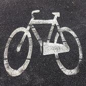 stock photo of bike path  - Symbol of bike path imprinted on the asphalt - JPG