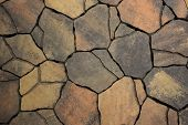 stock photo of paving stone  - Background from paving stones irregular natural stones texture - JPG
