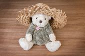 image of baby cowboy  - Toy teddy bear and hat on wooden background - JPG