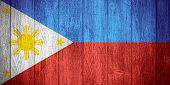 picture of filipino  - Philippines flag or Filipino banner on wooden boards background - JPG